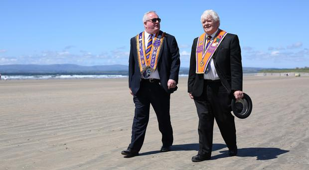 Two Orangemen enjoy the relaxed atmosphere at Rossnowlagh in Co Donegal