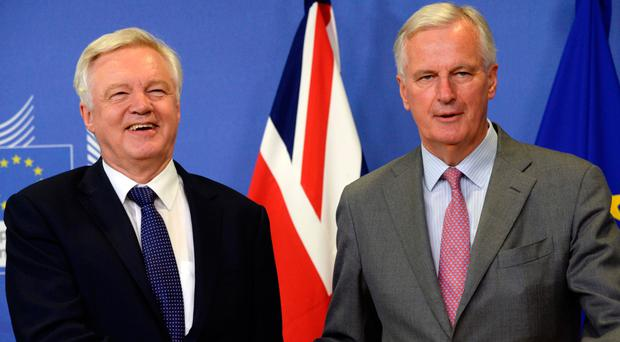 David Davis and the European Union Chief Negotiator in charge of Brexit negotiations with Britain Michel Barnier