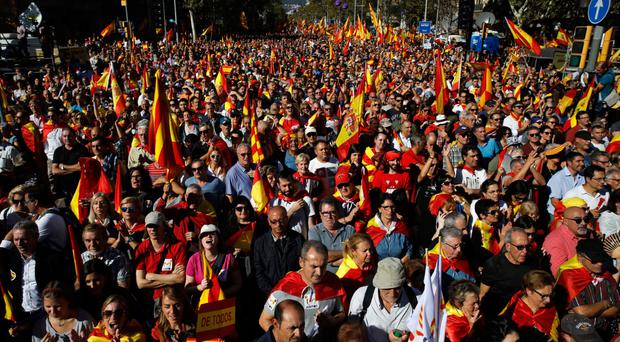 Nationalist activists march during a mass rally against Catalonia's declaration of independence, in Barcelona yesterday