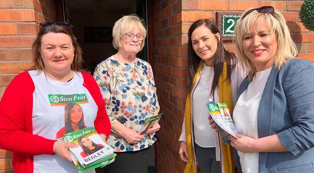 Sinn Fein's West Tyrone candidate Orfhlaith Begley (second right) meeting a constituent with the party's Stormont leader Michelle O'Neill (right) and West Tyrone MLA Michaela Boyle