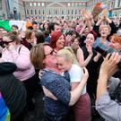 Yes campaigners celebrate at Dublin Castle on Saturday