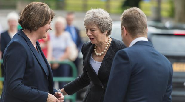 Arlene Foster greets Theresa May during the PM's visit here last week. Sinn Fein's policy of abstentionism has handed the DUP an unprecedented level of influence at Westminster