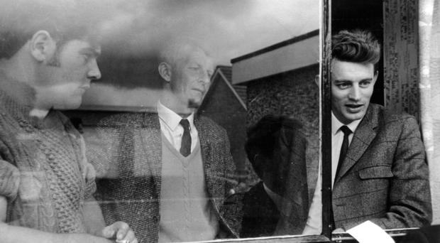 Austin Currie MP (right) and two colleagues squatting at a house in Caledon in June 1968