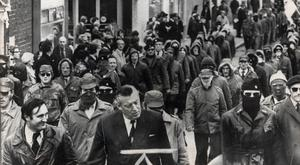 Ian Paisley marching with masked and hooded Loyalist paramilitaries protesting in 1974 against the Sunningdale agreement