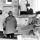 Police at the scene after William McConnell was shot dead by the IRA in 1984