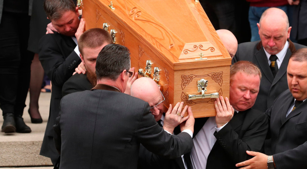 The coffin of Lyra McKee is carried out of St Anne's Cathedral in Belfast. Photo: PA