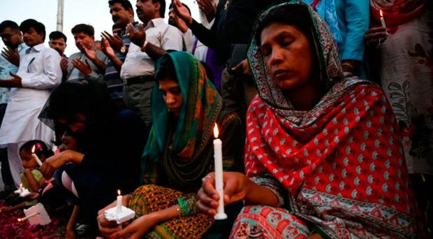 Pakistani Christians hold candles to pay tribute to the Sri Lanka blasts victims during a vigil in Islamabad in April