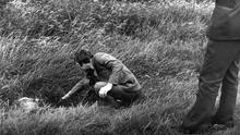 The body of murder victim Ann Ogilby lies in the grass beside the M1 motorway