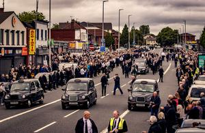 People line the road for Bobby Storey's funeral procession. Photo by Kevin Scott for Belfast Telegraph