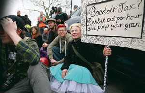 No laughing matter: A protester resorts to irony to articulate her opposition to the Coalition's hugely controversial bedroom tax.