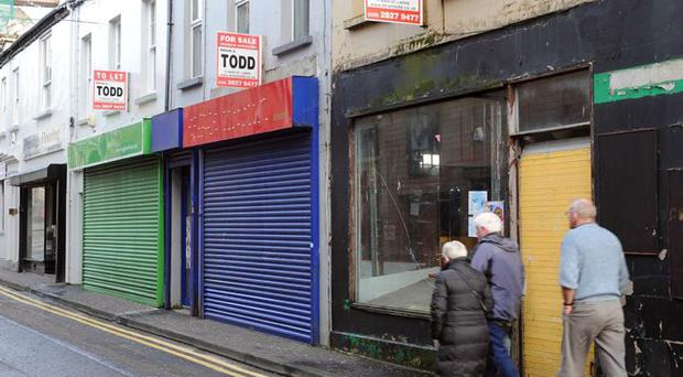 Boarded up shops like these in Larne town centre have become commonplace in Northern Ireland in recent years