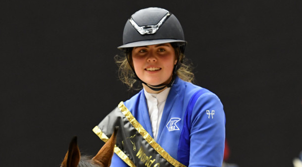 On top: Alex Finney is all smiles after her triumph
