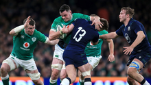 BATTLE: Ireland's James Ryan is tackled by Huw Jones of Scotland last week