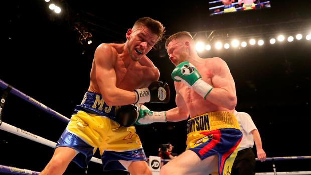 Just champion: James Tennyson lands a blow on Martin Ward during his impressive victory in London
