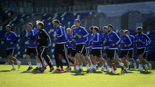 Racing to glory: Northern Ireland players training at Windsor Park yesterday before tonight's big match against Greece