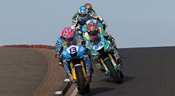 In action: Close racing in the opening Supersport race at the NW200 between Lee Johnston and Alastair Seeley