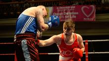 Big winners: Kane Tucker of Emerald on his way to victory over Gareth McDowell of Eastside in the lightheavyweight final