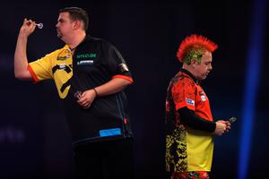 Wrong move: Peter Wright of Scotland in action during his third round match against Gabriel Clemens