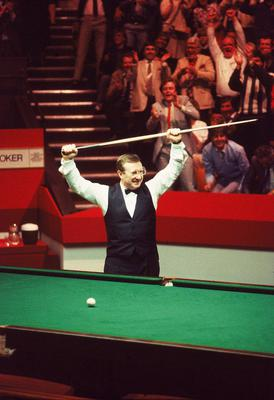 Special moment: Dennis Taylor celebrates his famous 1985 World title victory at the Crucible over Steve Davis