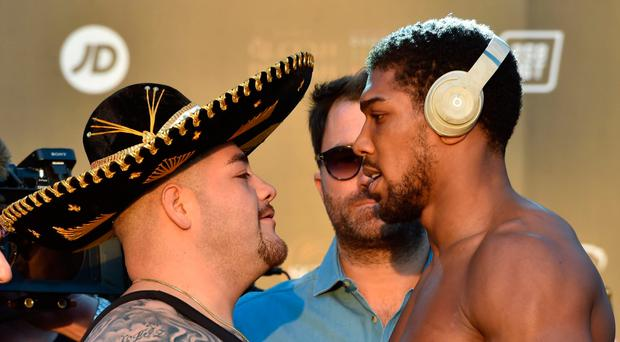 Face-off: Anthony Joshua (right) and Andy Ruiz at yesterday's Riyadh weigh-in