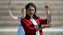 Delusion on a large scale: former Japanese swimmer Imoto Naoko holds the Olympic torch during the Flame Handover Ceremony for the Tokyo 2020 Summer Olympics in Athens, Greece, last week