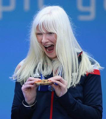 Kelly Gallagher shows off her Paralympic gold medal