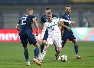 On the ball: Steven Davis takes on Bosnia in Sarajevo during the Nations League in 2018