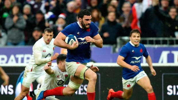 Powering through: France's Charles Ollivon dives in to score his side's third try at the Stade de France