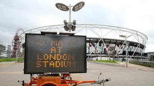 A view of an LED sign informing fans that the game is off outside the London Stadium, home of West Ham United (Steven Paston/PA)