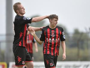 Top of the class: Jordan Stewart and Gavin Whyte celebrate after the latter's dazzling run and finish