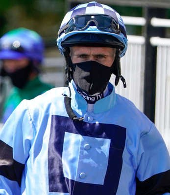 Jockey Paul Mulrennan wears a face mask as part of the effort to curb the spread of Covid-19