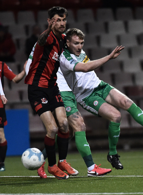 Tight battle: Crusaders ace Declan Caddell and Cliftonville's Chris Curran