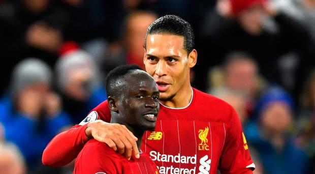 On the defensive: Virgil van Dijk says Liverpool's winning form makes conceding goals more easy to bear