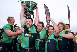 Silver delight: Ballynahinch captain Stuart Lamb lifts the AIB Cup