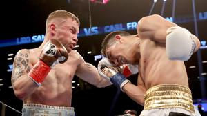 Champion: Carl Frampton sees off Leo Santa Cruz for the WBA featherweight title at the Barclays Centre in New York