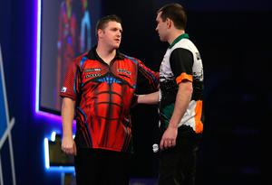 Top man: Daryl Gurney is congratulated by opponent William O'Connor