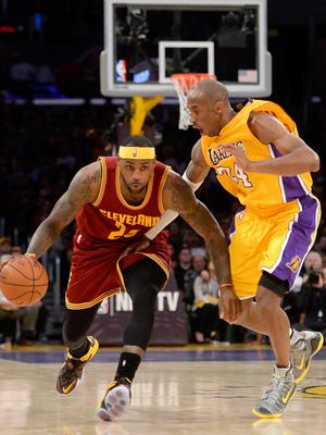Close relationship: LeBron James (left) and Kobe Bryant, who were like brothers, battle on the court in 2015