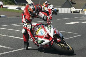 Taking a spill: Ian Hutchinson comes off his 600cc machine during practice for the North West 200 yesterday