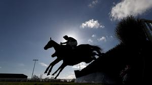 Horse racing will be held without spectators from Tuesday (Tim Goode/PA)