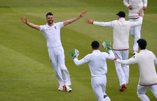 Magic moment: James Anderson celebrates the big wicket with his team-mates