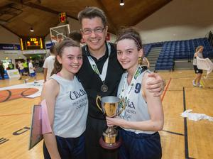 Schools glory: Enya and Anna Maguire celebrate All Ireland under-19 Cup success with Ulidia Integrated Carrickfergus along with dad Gareth in 2016