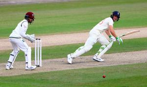 Steady progress: Jos Buttler plays a shot during his partnership with Ollie Pope who was in fine form