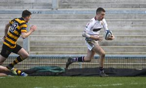 Zooming in: Royal School Armagh ace Ethan McAtarsney bags a try