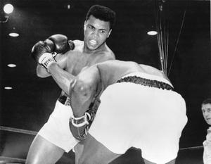 Cassius Clay (now Muhammad Ali) in action against Sonny Liston during their heavyweight title fight  February 25, 1964 in Miami Beach, Florida. Clay won the contest, becoming world champion, when Liston failed to come out at the start of the seventh round.