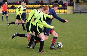 Race is on: Knockbreda's Curtis Black and David Johnston chase Crusaders Reserves' Ross Holden