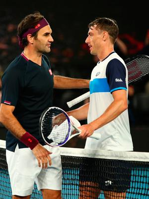 Long haul: Roger Federer (left) and John Millman at the finish