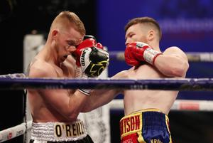 Take that: Belfast's James Tennyson lands a hard uppercut right on the nose of Josh O'Reilly on Friday night