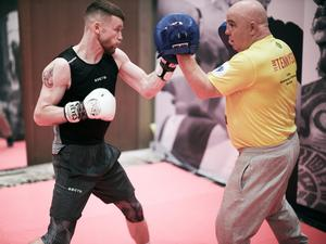 Gearing up: James Tennyson in training with coach Tony Dunlop for Friday's bout