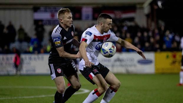Battle: Conor McCormack and Dundalk's Michael Duffy