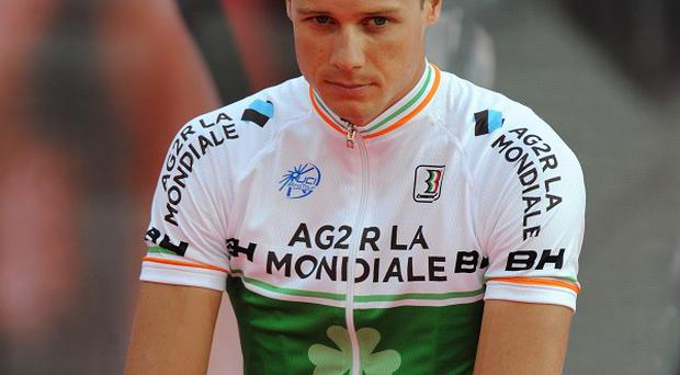 Nicolas Roche, pictured, holds a 17-second cushion over American Chris Horner